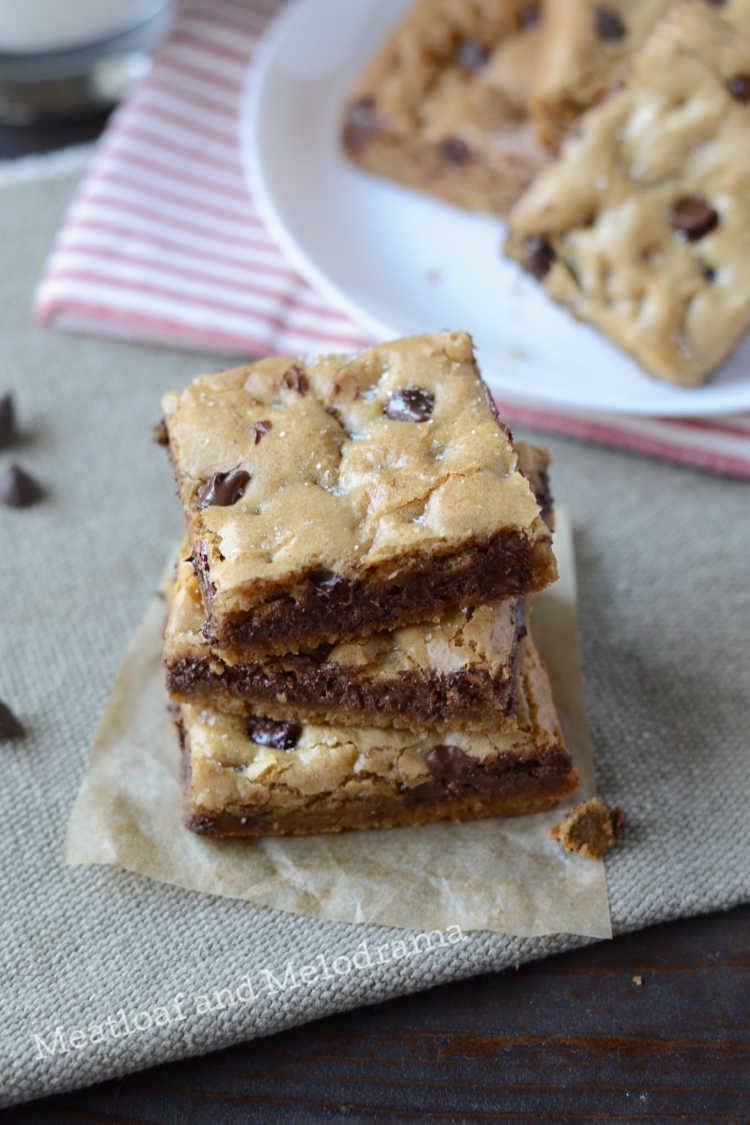 the best chocolate chip cookie bars ever stacked on table