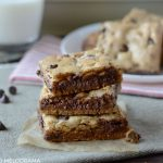 the best chocolate chip cookie bars ever stacked with milk