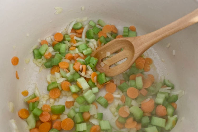 saute onions, celery and carrots in dutch oven