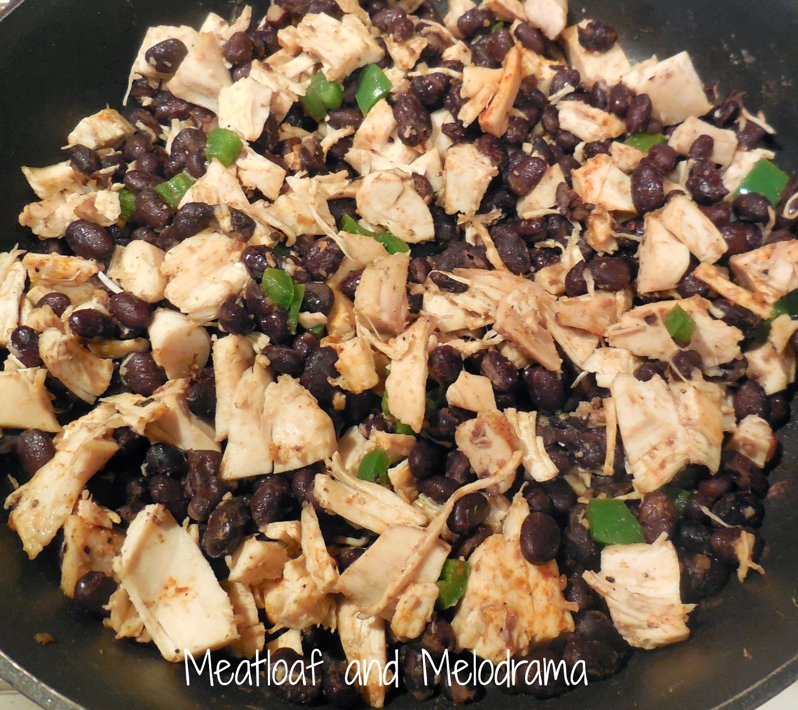 chicken, black beans and jalapenos in skillet