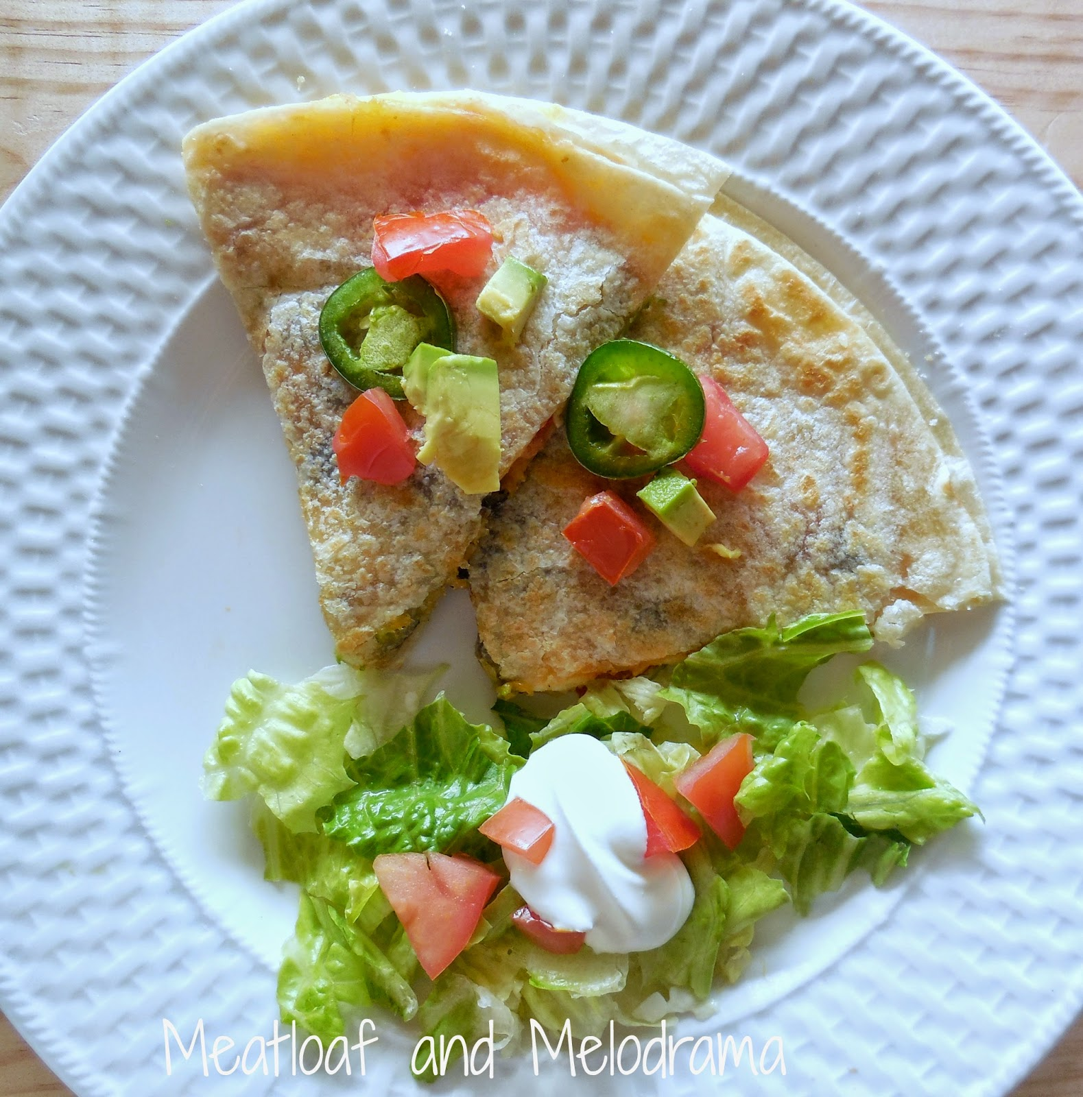 quesadillas with jalapenos, tomatoes, avocados on a plate