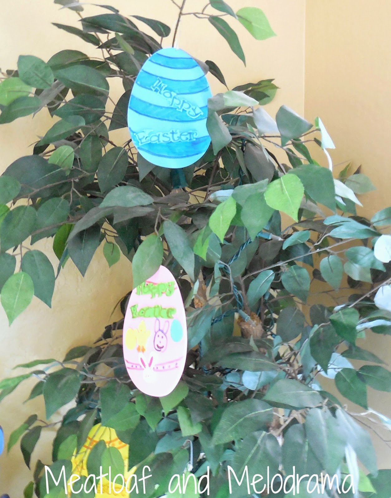 decorated foam eggs hanginf from tree