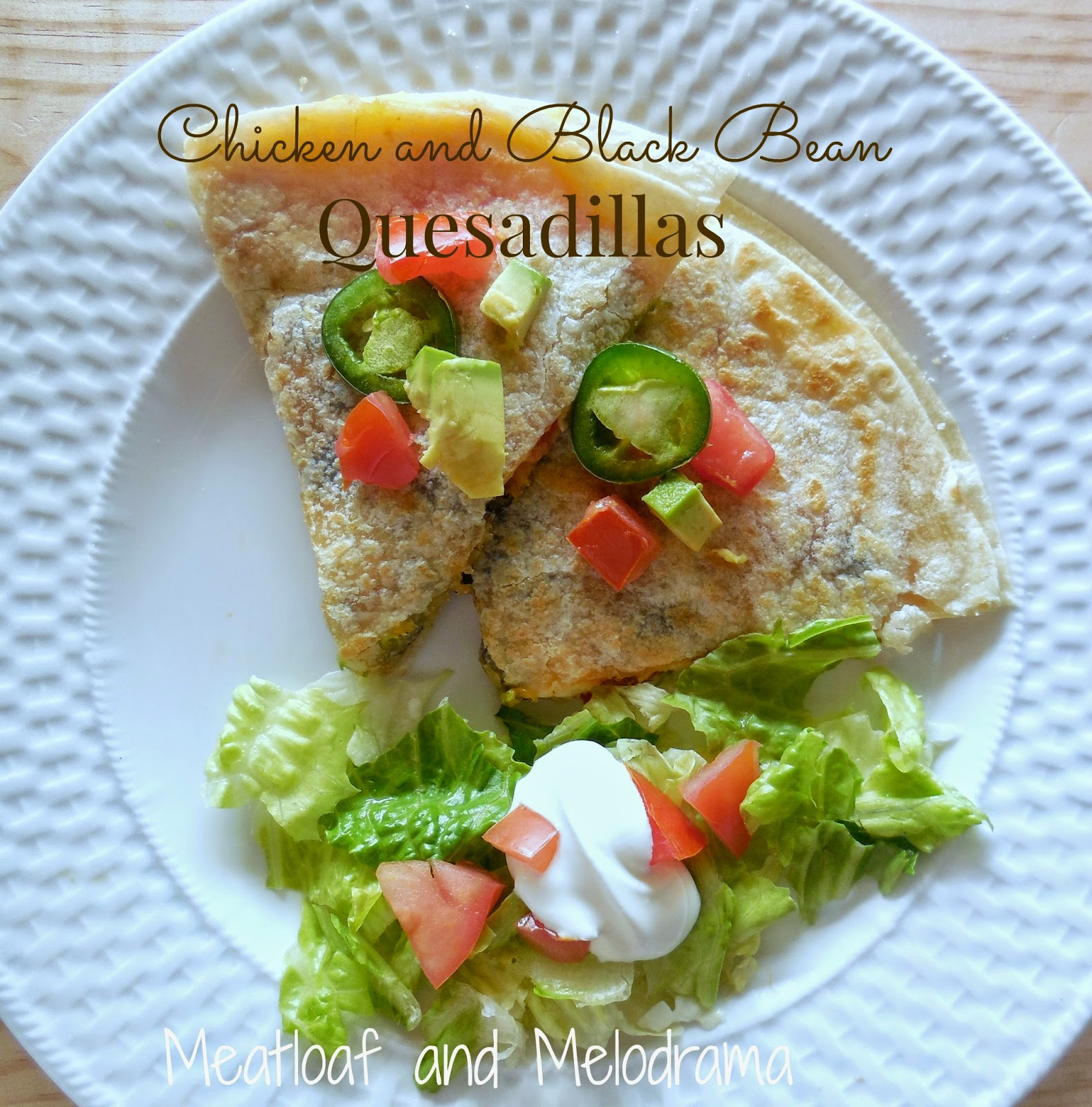 chicken and black bean quesadillas with jalapenos, tomatoes, sour cream and lettuce