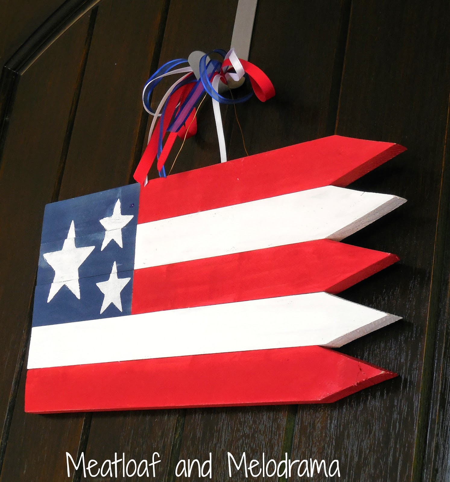 wooden American flag made from garden stakes on front door