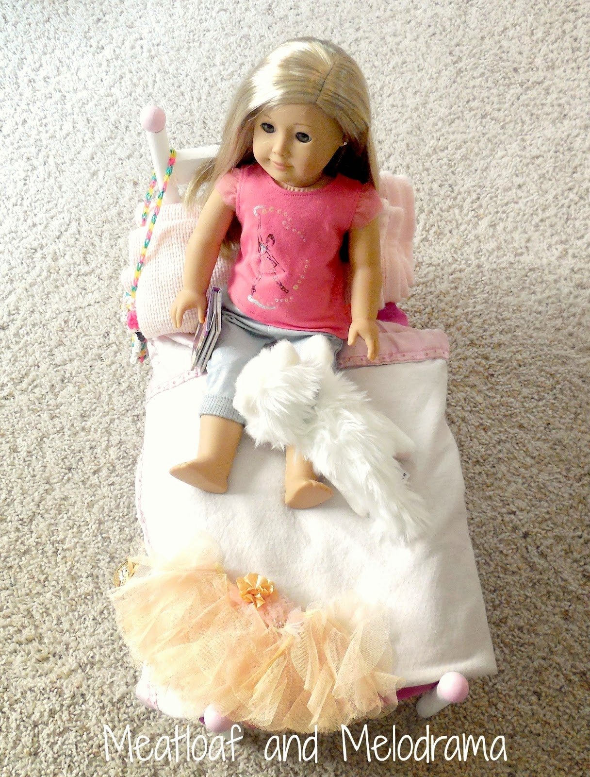 american girl doll Isabelle in handmade pink and white doll bed