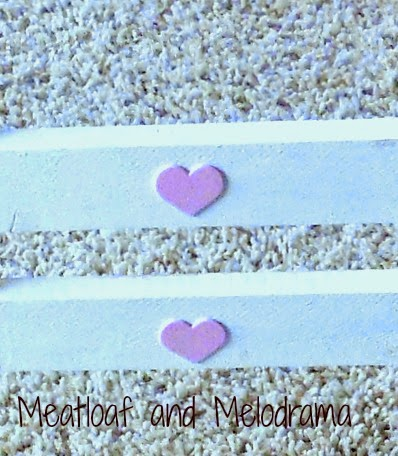 pink hearts on headboard of doll bed