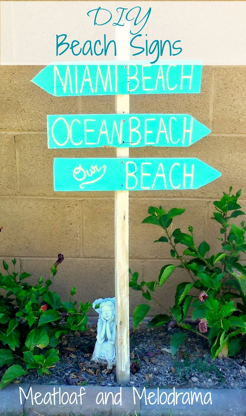 wooden hand painted beach signs on a wooden stake