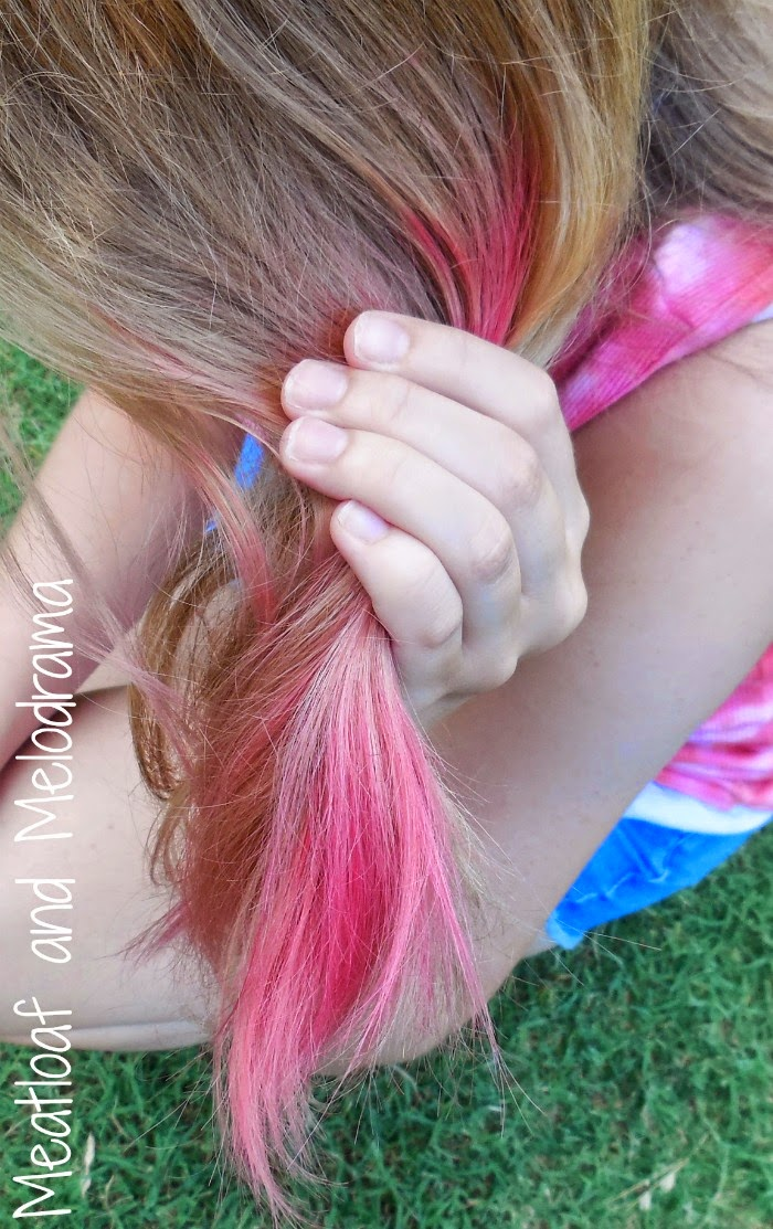 blonde girl with pink hair color made with food coloring