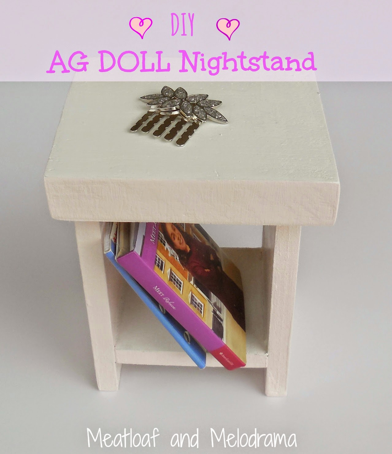 ag pink and white wood doll nightstand with books