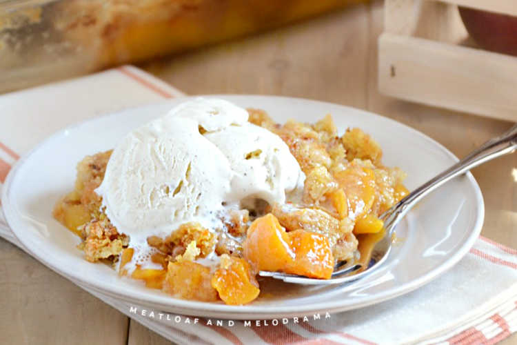 peach cobbler with cake mix topping and ice cream
