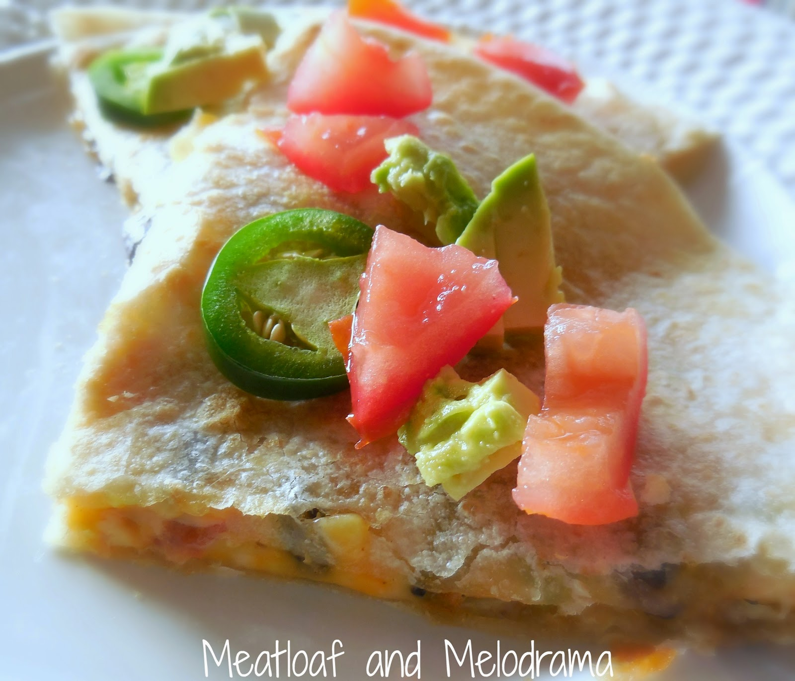 chicken and black bean quesadillas with jalapeno peppers, avocado and tomatoes