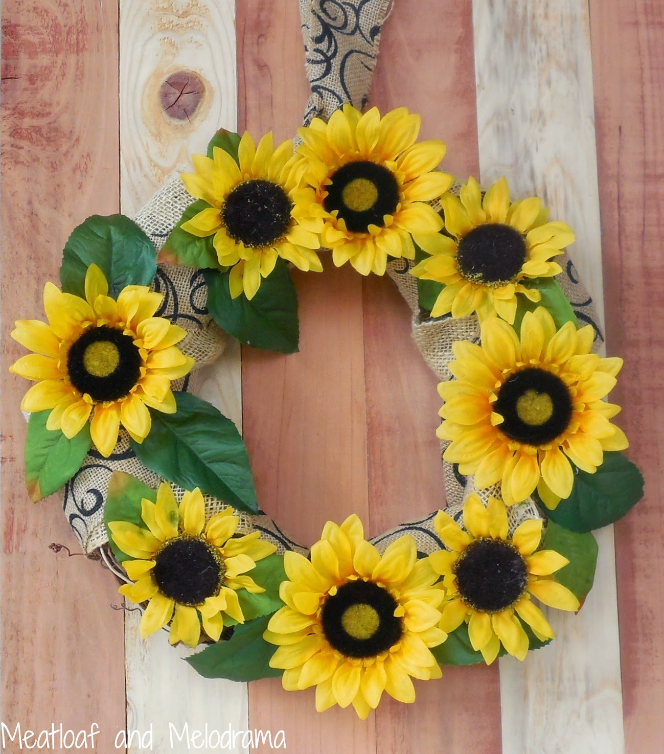 fall yellow sunflower and printed burlap wreath on wood