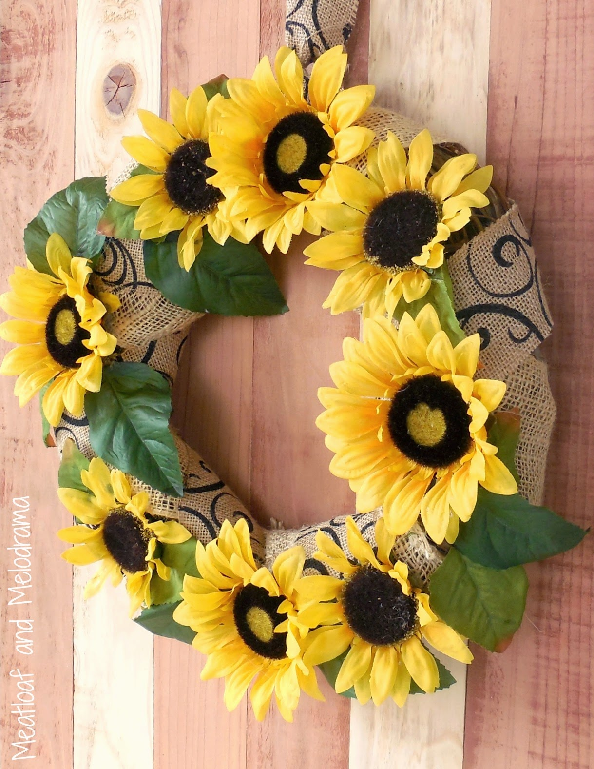 fall sunflower and burlap wreath on wood board