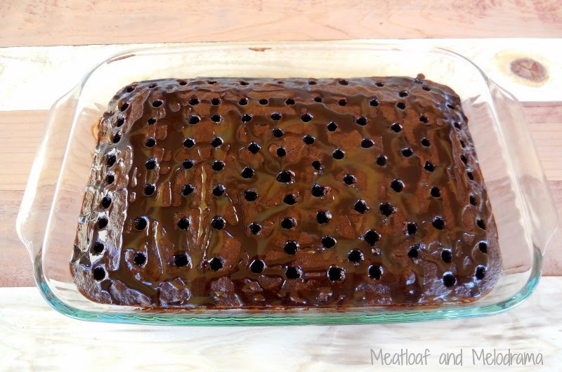 poke holes in chocolate cake with a drinking straw