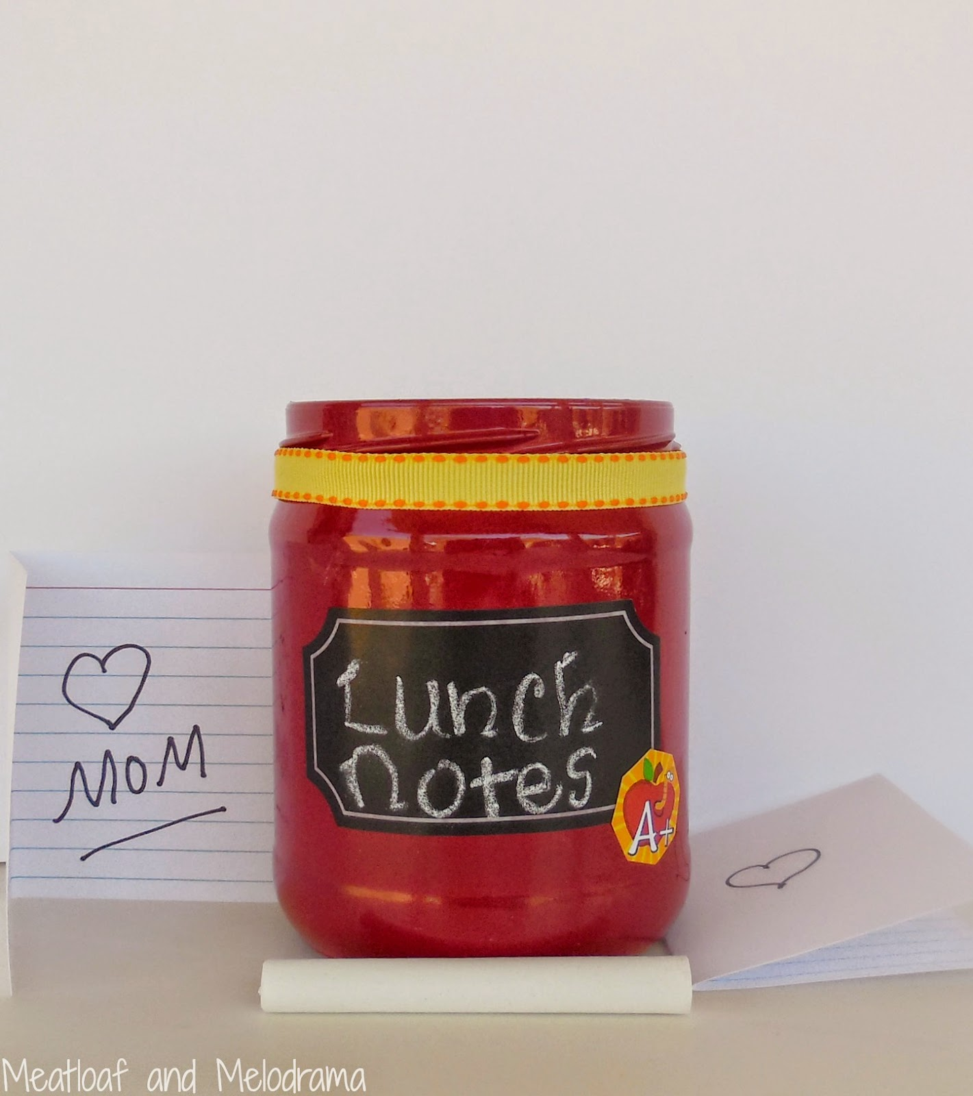 salsa jar with red spraypaint, chalkboard label and notes for school lunch boxes