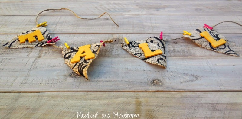 burlap flags attached to twine with mini colored clothespins