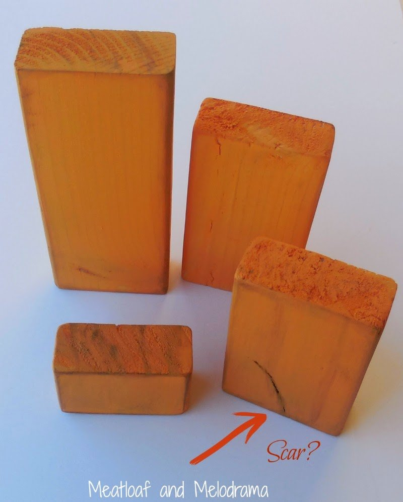four wood blocks painted orange