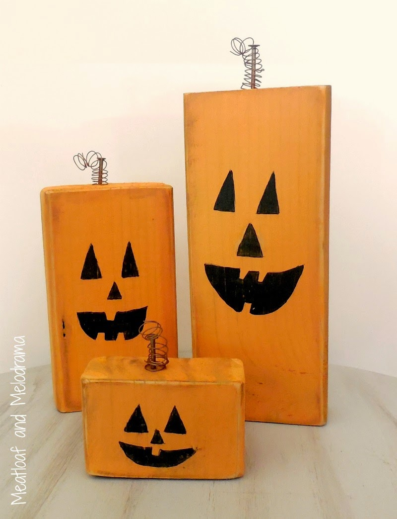three wood pumpkins made from wood blocks