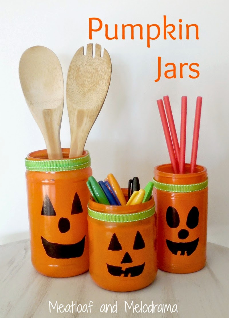 jars recycled into pumpkin containers for halloween