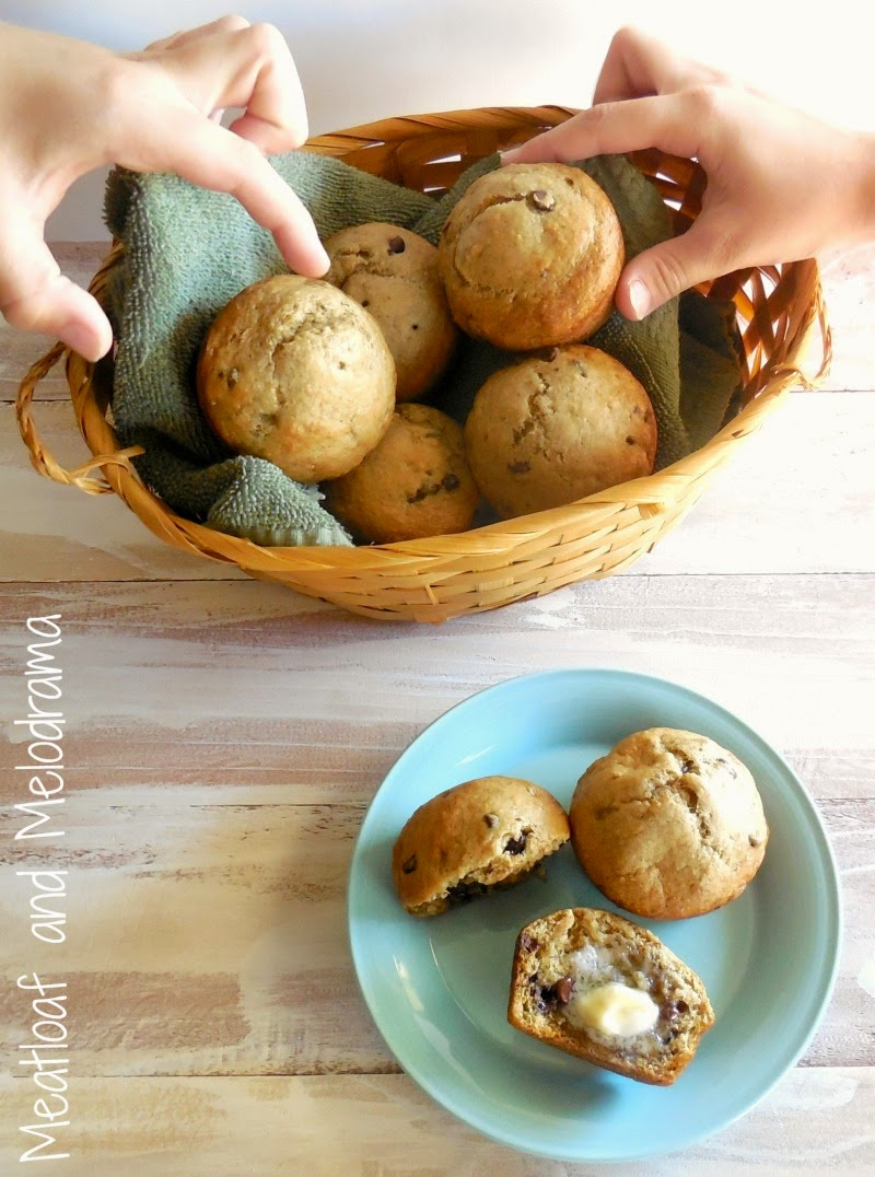 kids taking banana applesauce muffins out of a basket