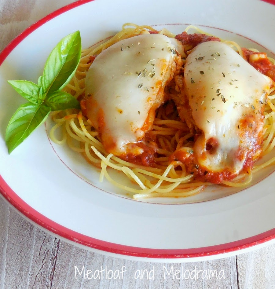 chicken parm covered with melted provolone cheese and marinara sauce over spaghetti pasta