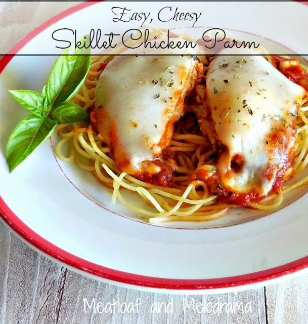 chicken parmesan covered with melted cheese on spaghetti with basil