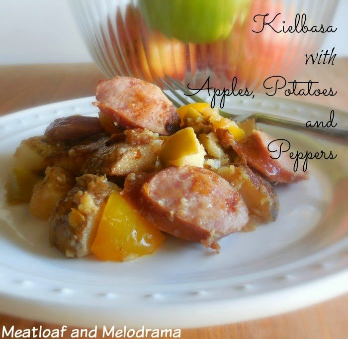 dish of kielbasa sausage with yellow peppers and apples and potatoes