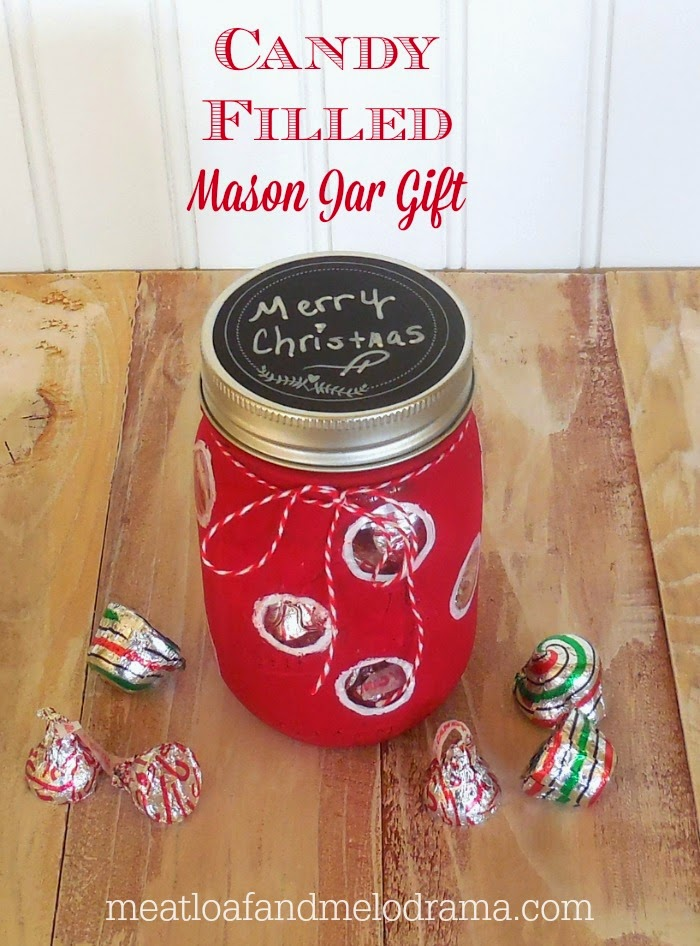 red and white mason jar painted with americana chalky finish and filled with peppermint kisses and