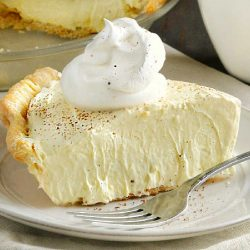 slice of eggnog pie on a plate with cool whip