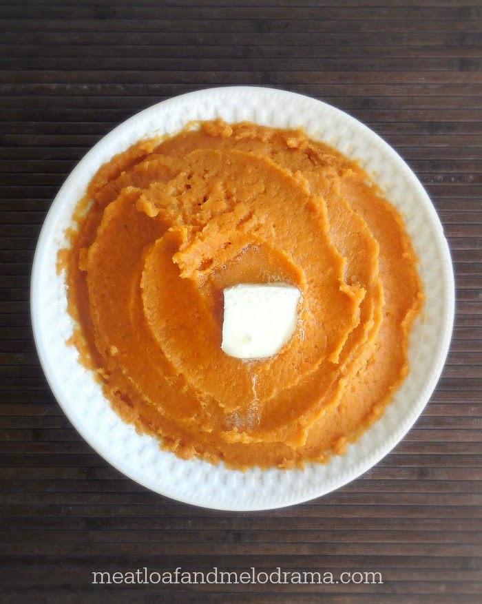bowl of mashed sweet potatoes with butter on top