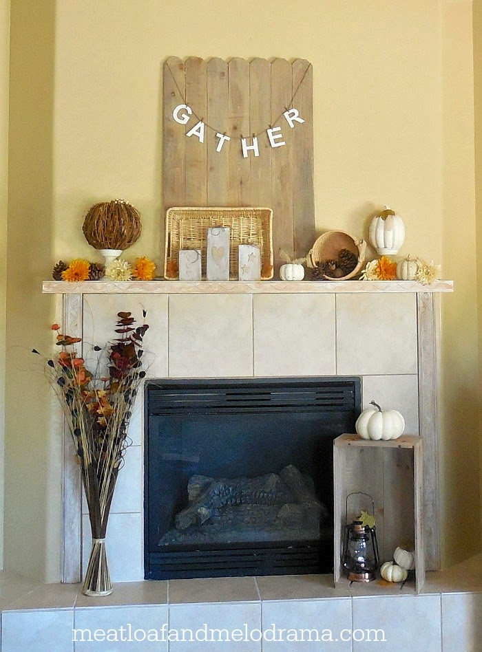 rustic fall mantel and hearth with white pumpkins candlesticks crate and flowers
