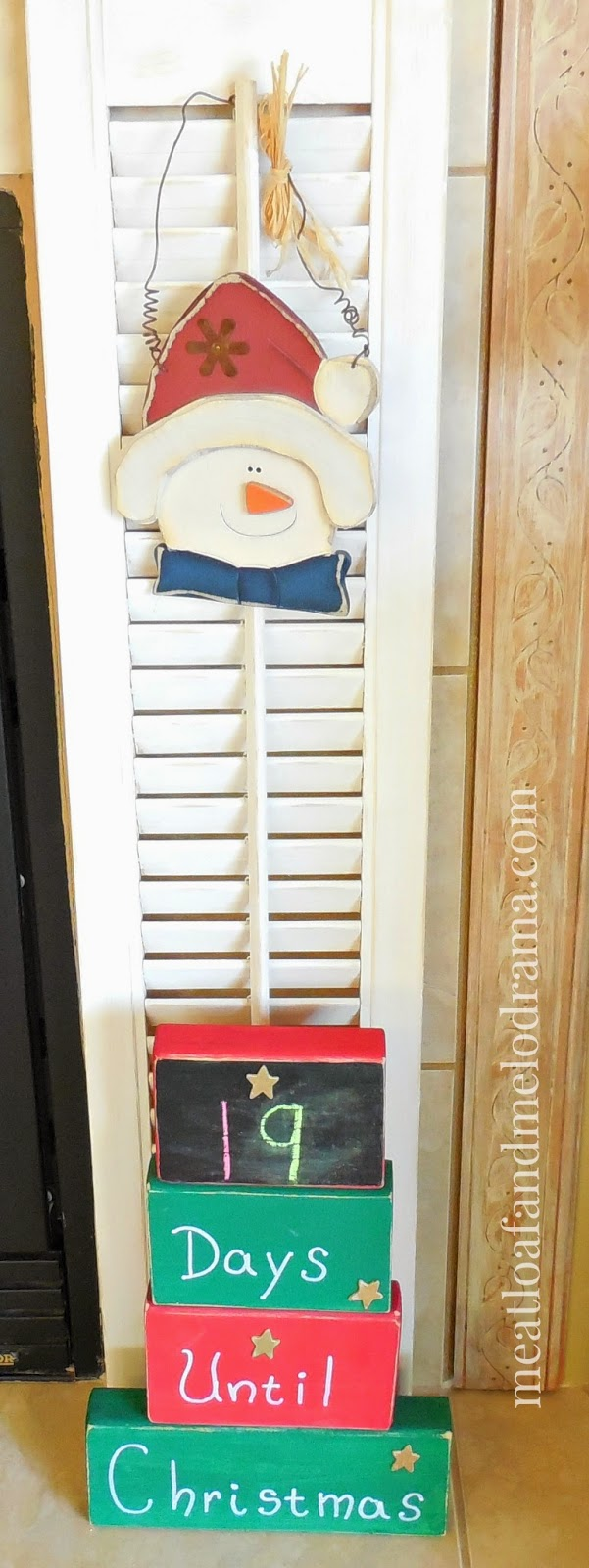 salvaged shutters with diy christmas countdown calendar blocks