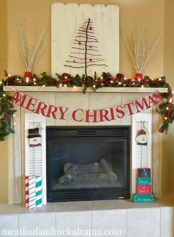 rustic fireplace decorated with twig tree salvage shutters wood countdown calendar and pine garland
