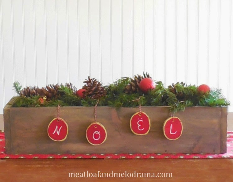 diy wood box centerpiece with pine cones pine garland and wood slice ornaments - Rustic Christmas Centerpieces