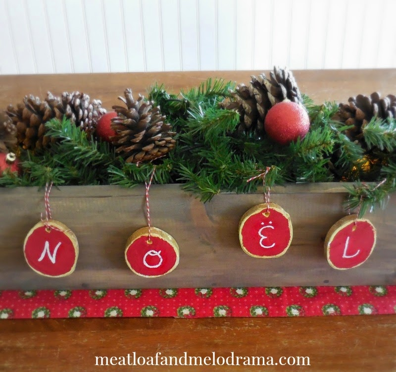 rustic wood box centerpiece with diy wood slice ornaments spelling noel - Wooden Box Christmas Decorations