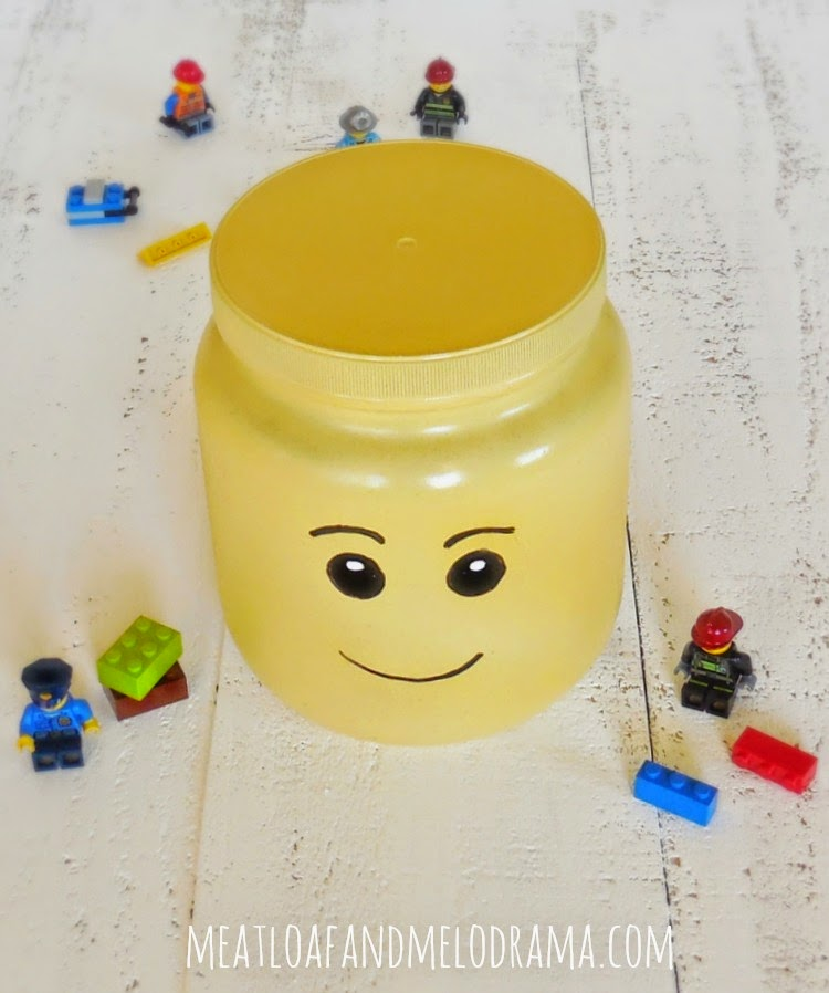 large lego head storage container made with rust-oleum spray paint and large plastic jar