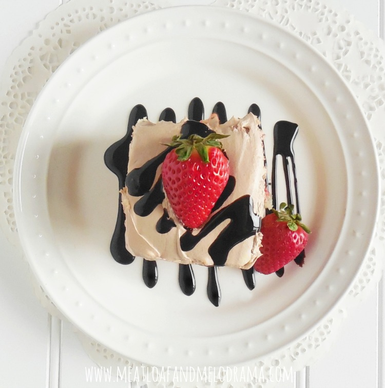 strawberry poke cake with strawberries and chocolate frosting