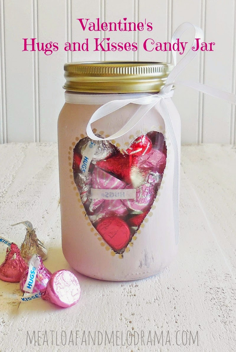 Chalk painted mason jar with heart cutout filled with candy hugs and kisses