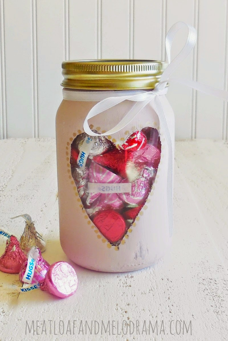 pink chalk paint mason jar heart cutout filled with valentines day candy