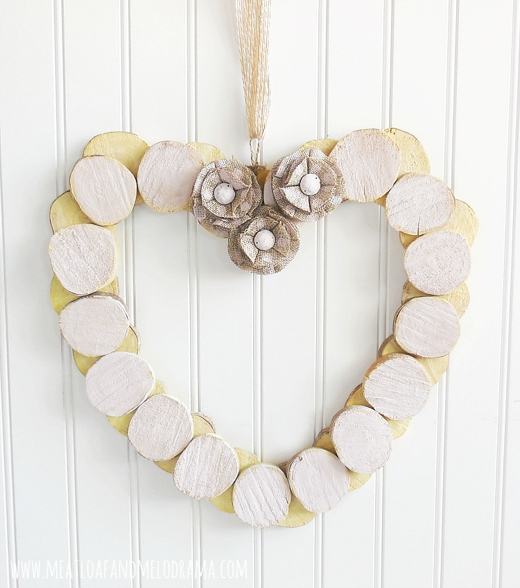 heart wreath made from wood slices and pink chalk paint
