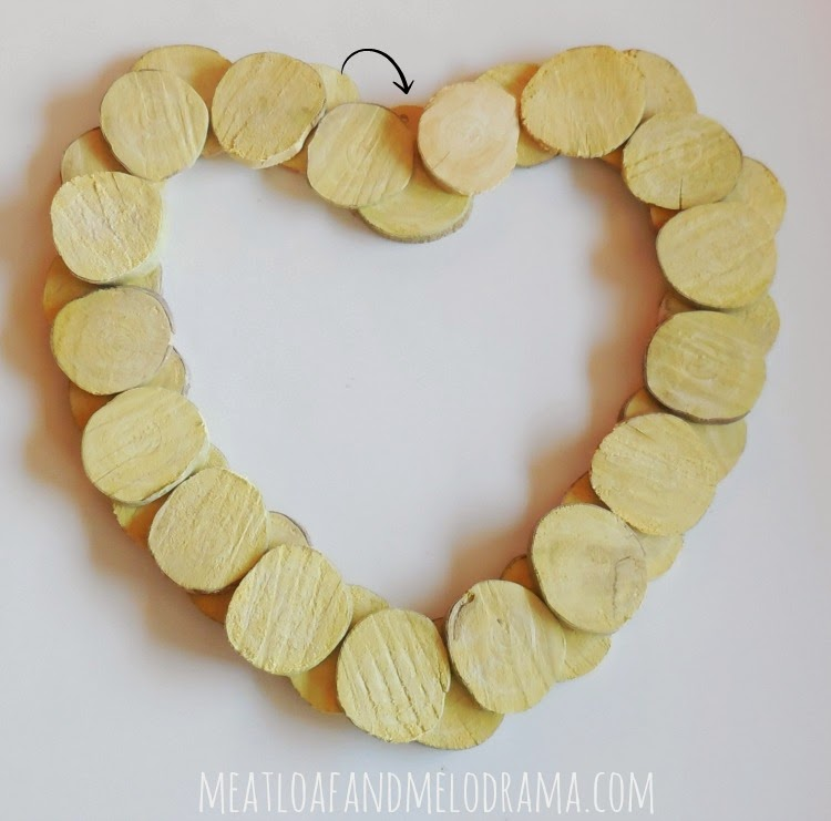 wood slices glues to make valentines day heart wreath