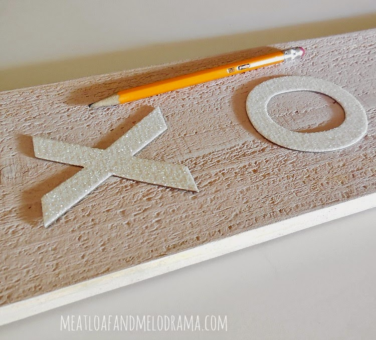 trace around cardboard letters with a pencil