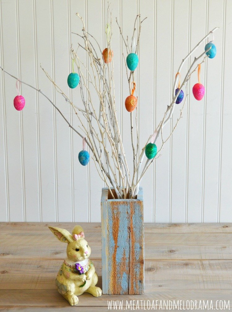easter tree with painted white branches and diy glittered easter eggs