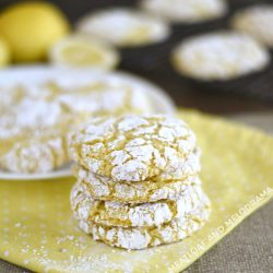stack of lemon crinkle cookies with powdered sugar