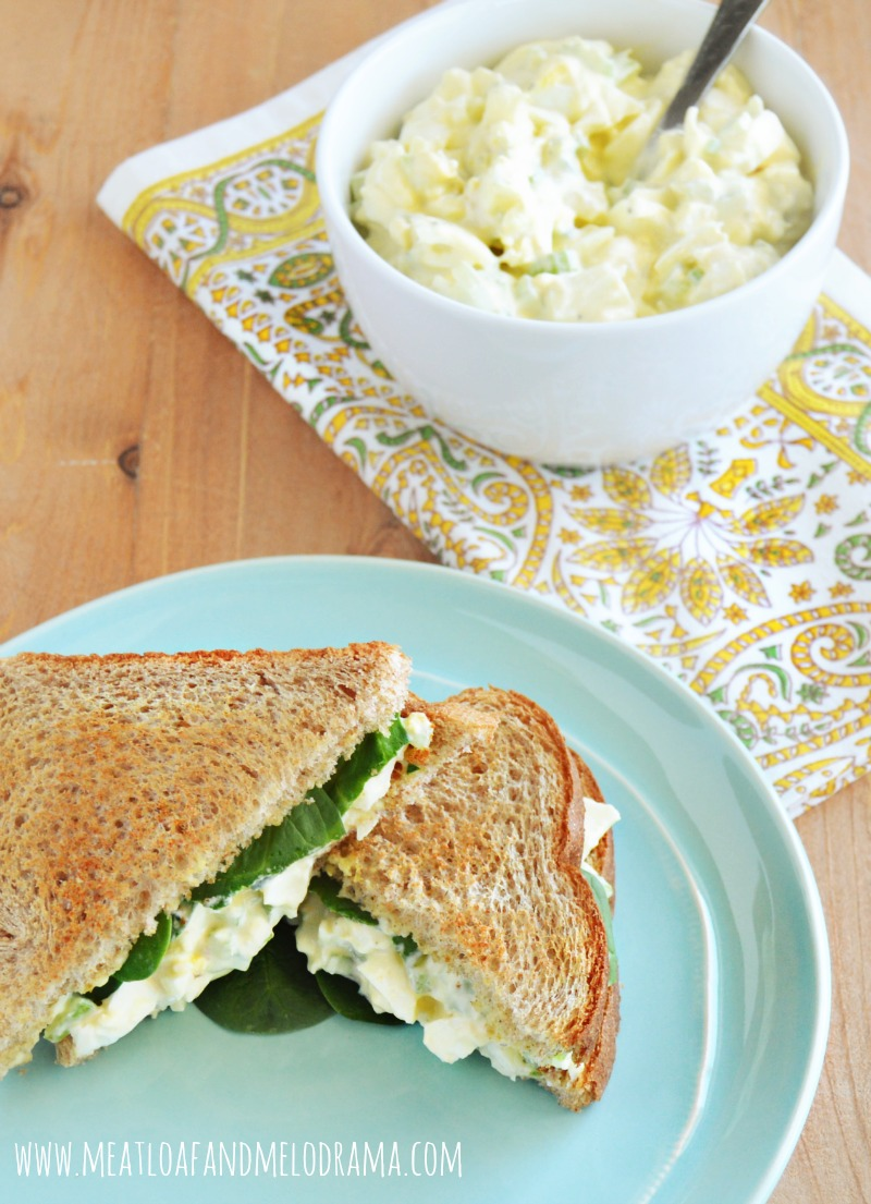 egg salad sandwich on a plate with a bowl of egg salad