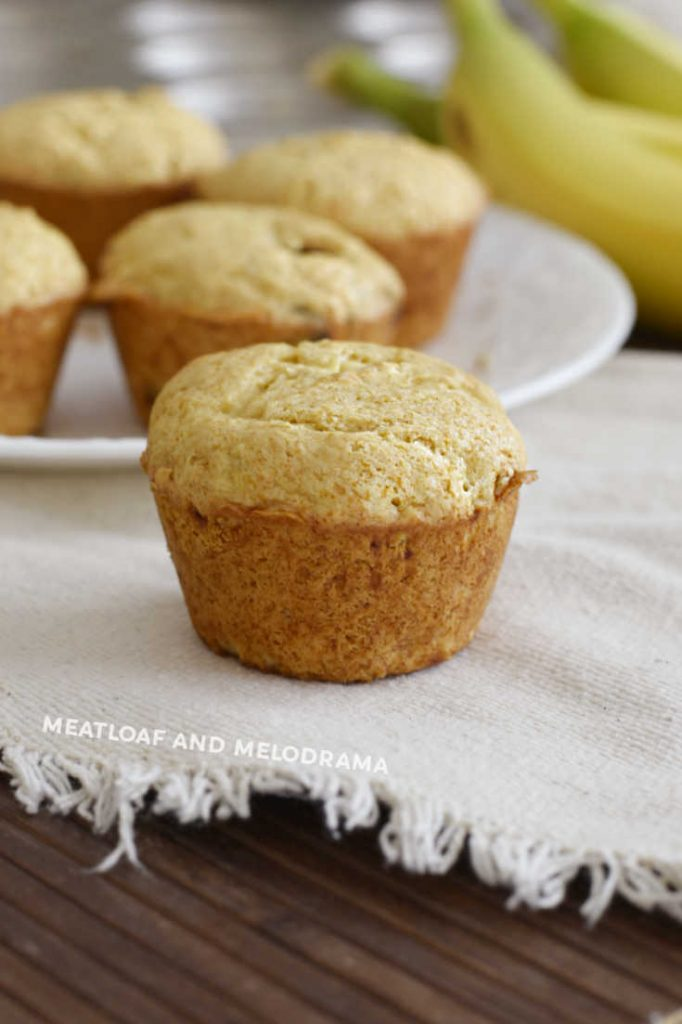 banana muffin on a tan placemat