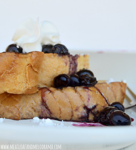 french toast topped with blueberries and whipped cream