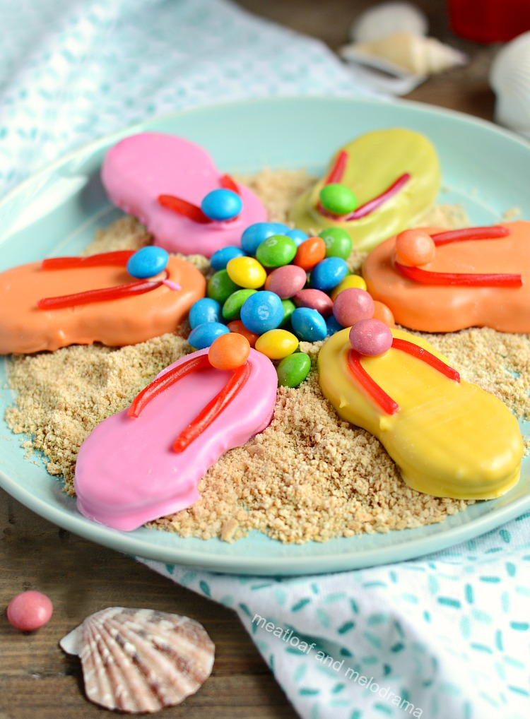 nutter butter easy flip flop cookies with candy melts and skittles and twizzlers on plate with crushed graham crackers