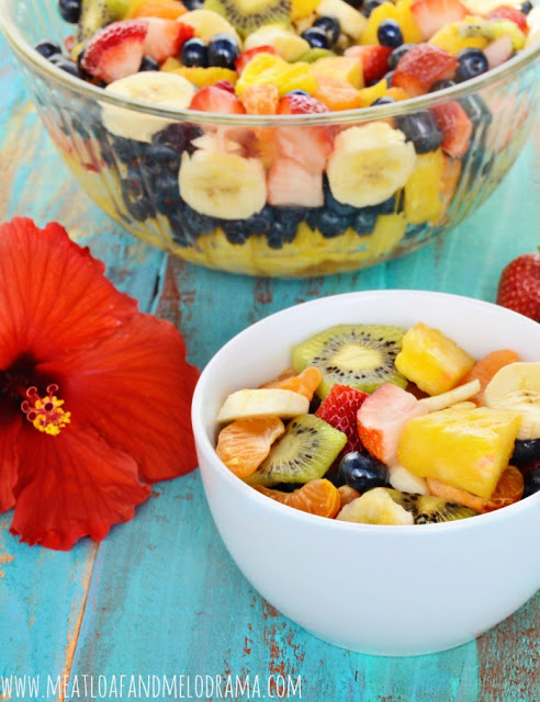 bowls of fruit salad and hibiscus flower