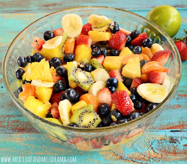 fruit salad made with bananas and pineapple and blueberries and mandarins and strawberries and kiwi